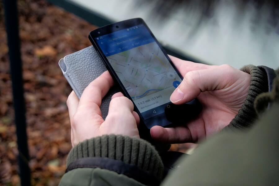 Man looking at google maps on his Android smartphone.
