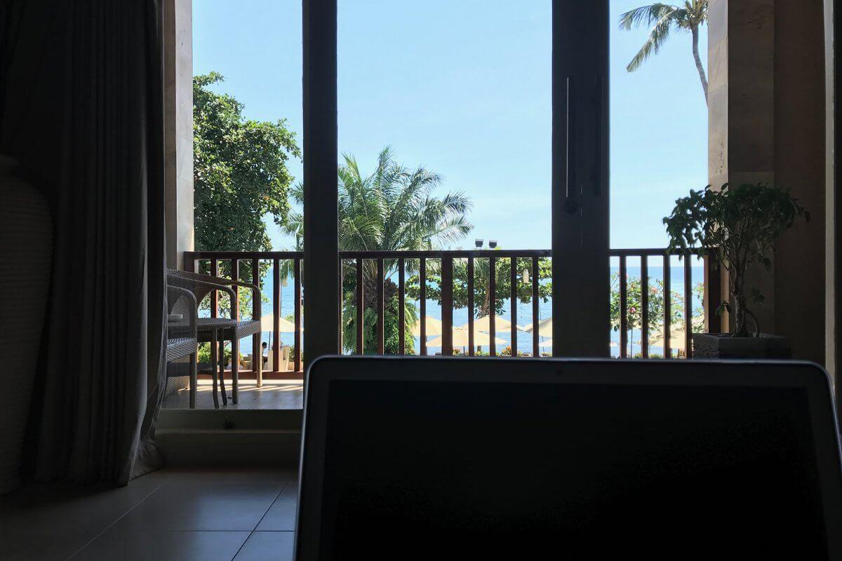Laptop in oceanfront hotel suite (digital nomad nonsense)